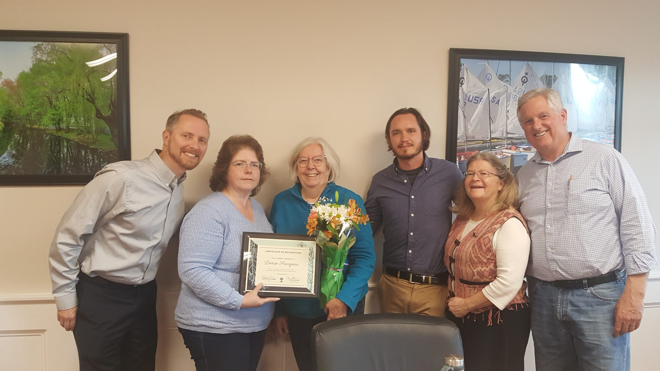 Board members and Executive Director celebrate Denise Savageau and time with SWCD